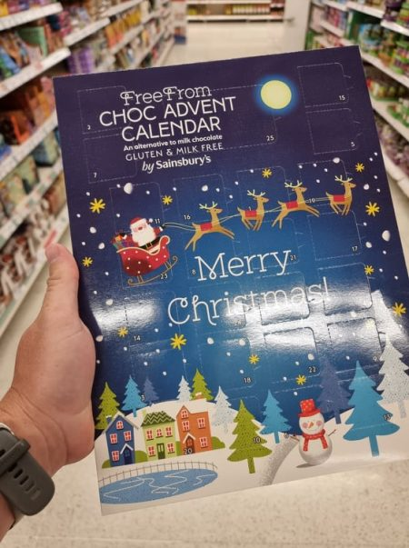 hand holding free from  advent calendar at the  supermarket