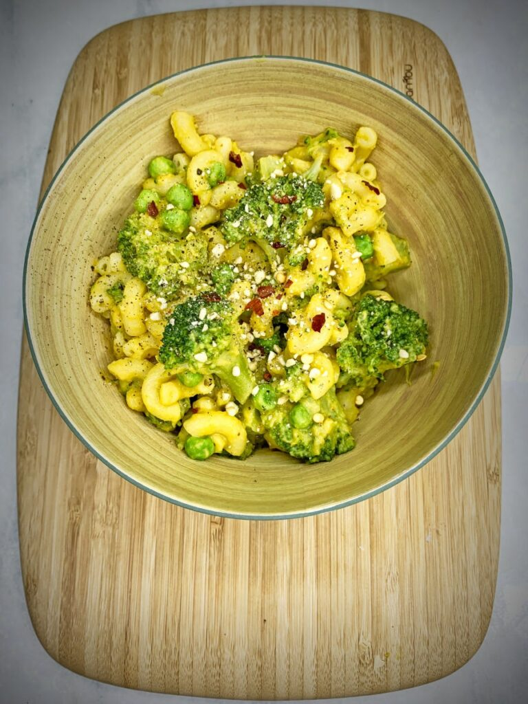 Creamy Hummus Mac and Cheese with broccoli and peas