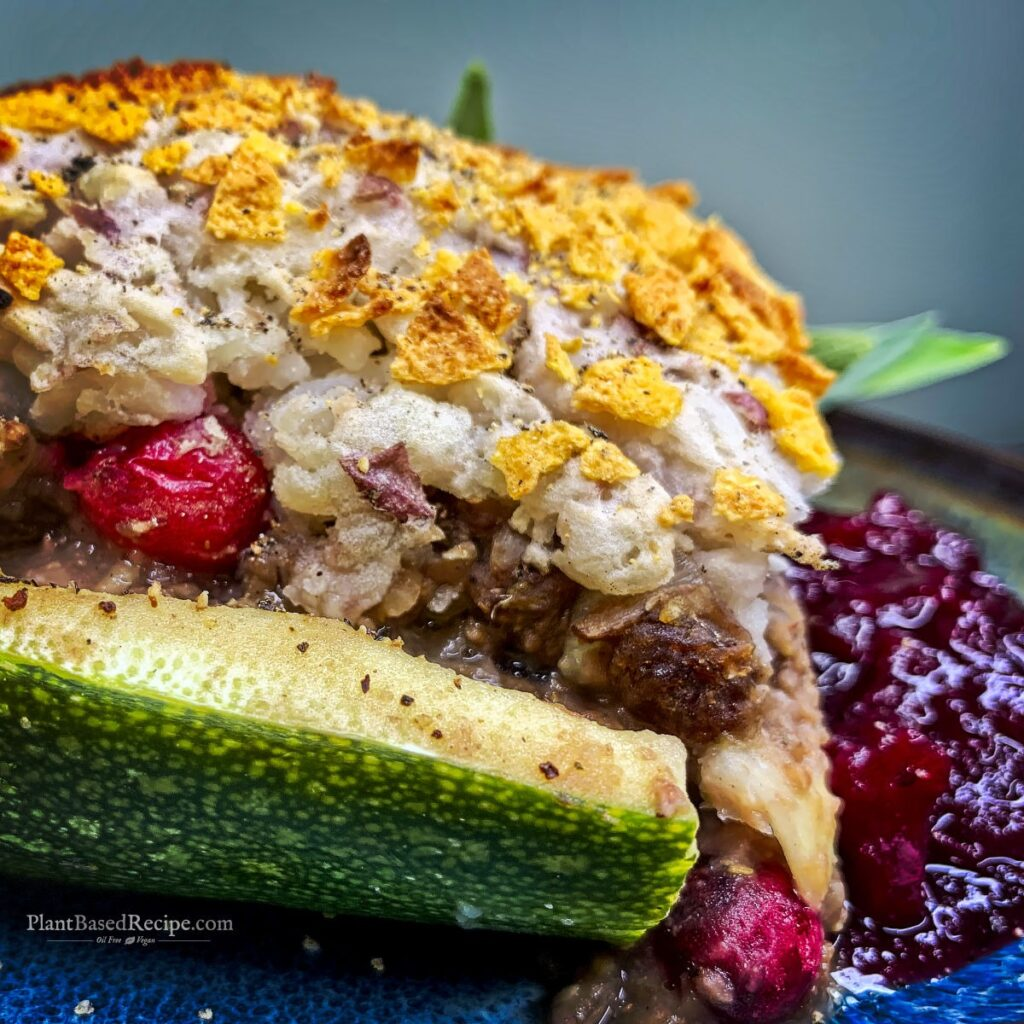 close up of the holiday zucchini boat with cranberry