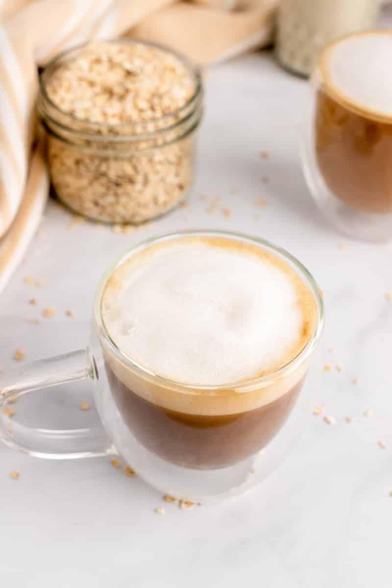 glass of oat milk latte on table