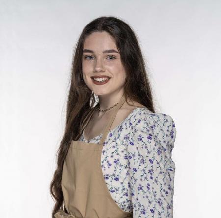 Freya in bake off apron
