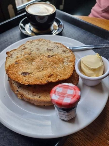 tea cake next to coffee jam and butter