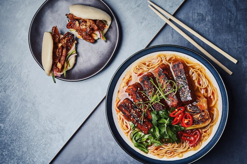 Photo shows two plant-based dishes from Wagamama's latest menu, which is now 50 percent vegan-friendly.